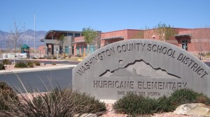 Front of school with stone sign that reads Washington County School District Hurricane Elementary